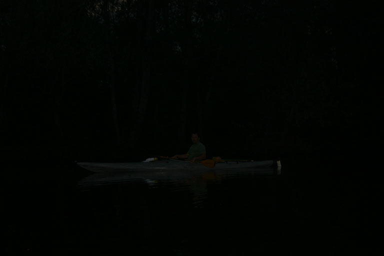 Jim in the dark paddling